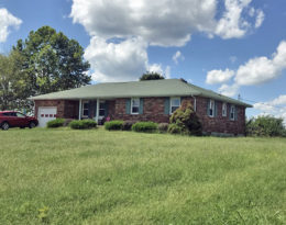 Brick Ranch Home And Shop On 1.7 Acres M/L.